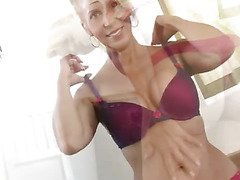 Breasty Anilos cougar uses a vibrating egg on her nipples and muff