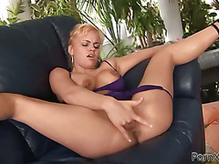 This golden-haired slut climaxes loudly from fingering