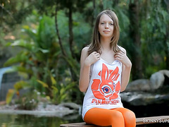 Enchanting and beauty solo teen Vika Nymph is masturbating outdoors