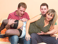 Check out this playful blonde playing with two huge boners
