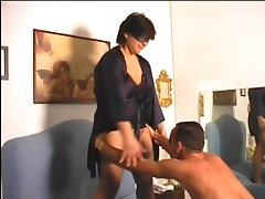 Chubby wife strokes him and fucks him with strapon