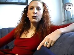 Redhead German plays with dildo