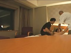 Asian couple in hotel room