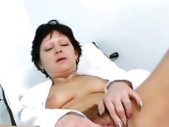 Hairy Vixen Stretches Cunt Over Gyno Chair