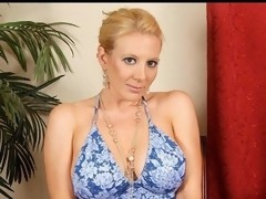 Glamorous aged golden-haired Anilos removes her clothing and flaunts her mesmerizing cougar frame
