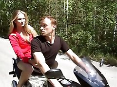 Guy and angel are riding motorbike feeling powerful temptation to have wild pounding